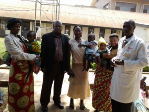 group of parents, children and clinic staff