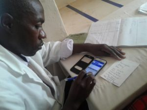 clinic worker enters data on mobile app