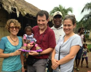 l to r: chesca, nick kristof holding miracles, augustine, jen