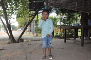 Rottanak with fully corrected feet standing outside