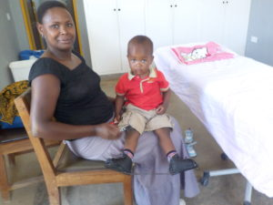 Samsoni sits on his mom's lap